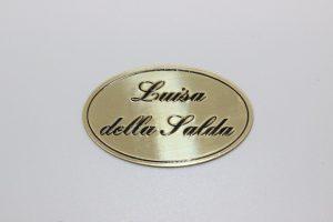 targhetta serigrafata in ottone